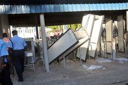 Angry commuters vandalised security screening equipment at the channel.jpg